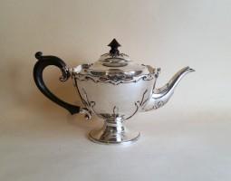 Edwardian cut card silver teapot