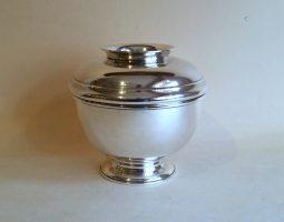 Silver covered sugar bowl