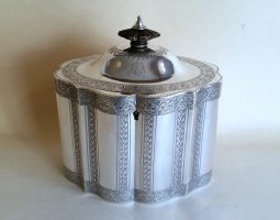George III silver bright cut Hennell tea caddy