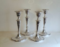 Set of four Victorian silver candlesticks