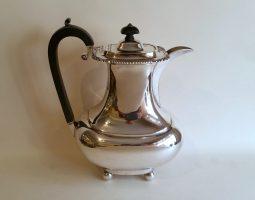 Edwardian silver hot water jug
