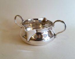 Silver double-lipped cream jug