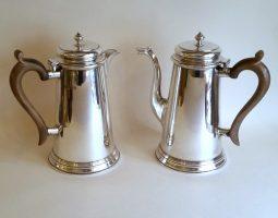 Pair of silver cafe au lait pots