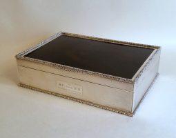 Silver and tortoiseshell cigarette box