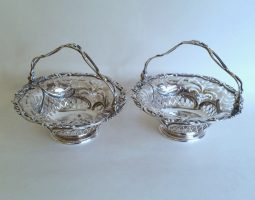 Pair of George III silver epergne baskets