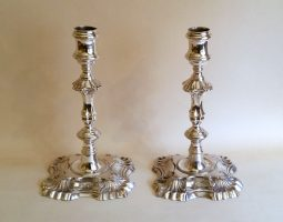 George II silver cast candlesticks